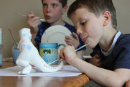 pottery painting a T Rex