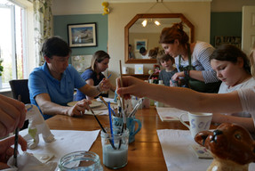 family pottery painting session at home