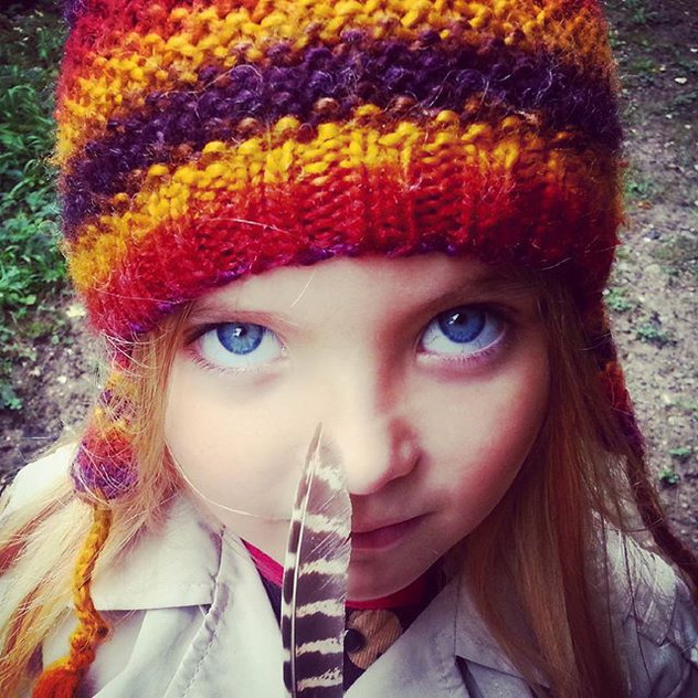 She found a little feather in the woods #feather #wildandfree #naturechild #bigblueeyes #woodlands