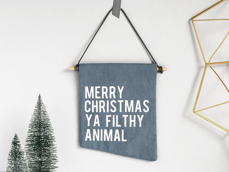 Merry Christmas Ya Filthy Animal banner