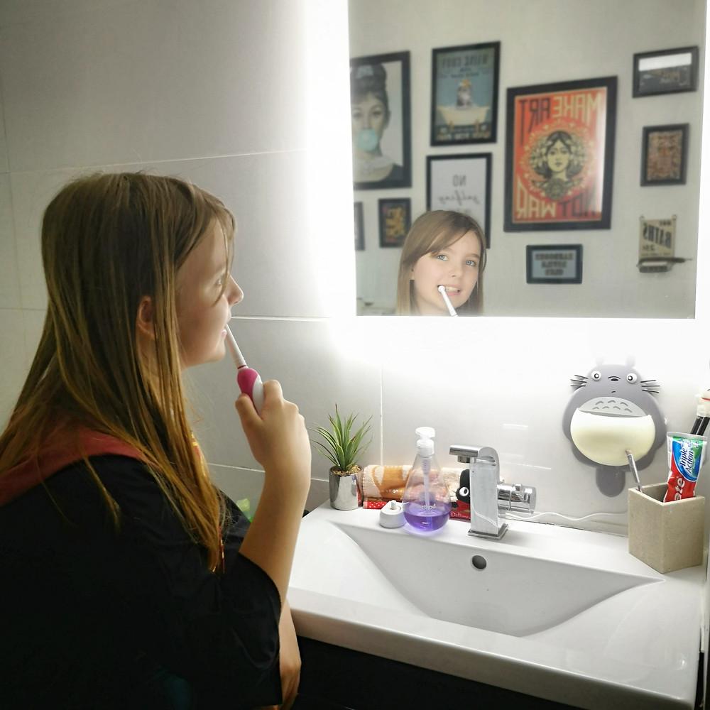 child brushing teeth saving water