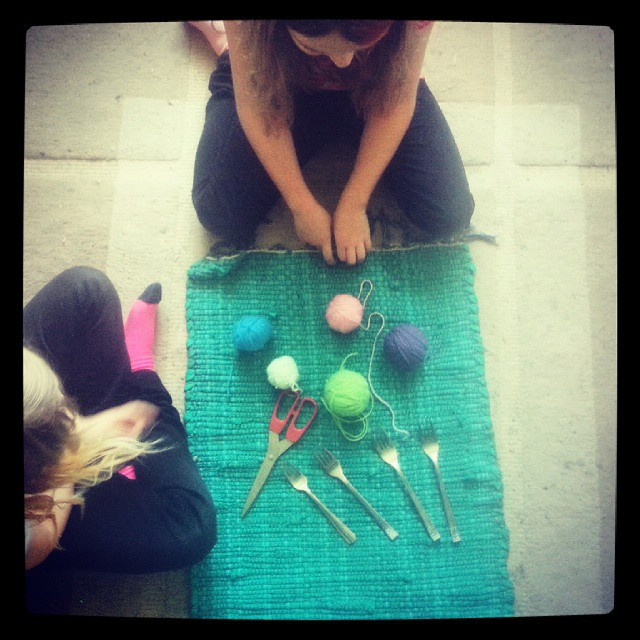 Instagram - Teaching the kids to make pompoms out of wool and forks.jpg