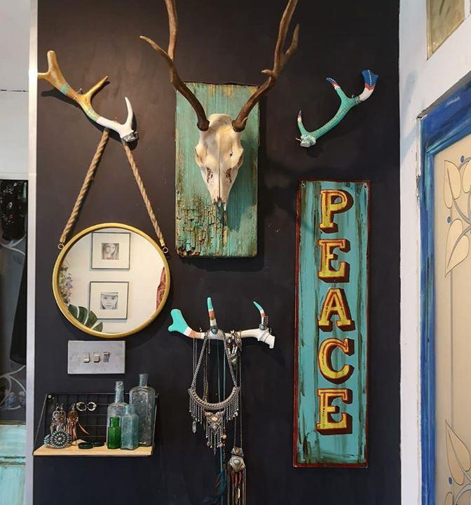 deer skull and painted antler decor