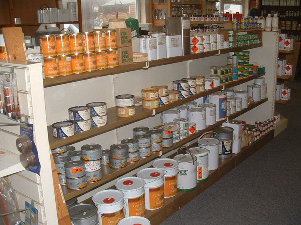 tins of woodstain and wood paint