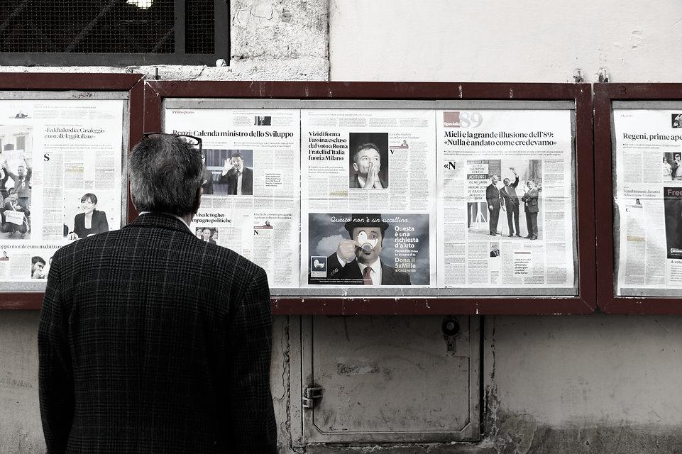 man%20reading%20newspaper%20in%20bulletin%20board_edited.jpg