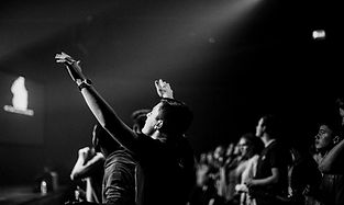 Guy with hands up worshipping