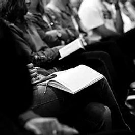 People holding Bibles in black and white