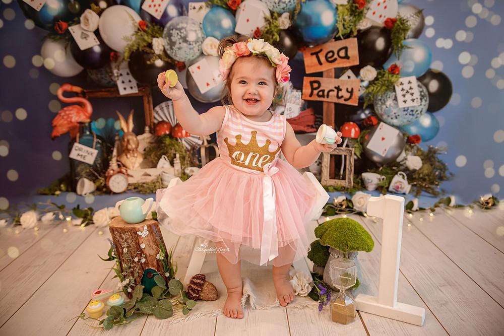 alice in wonderland tea party cake smash photographer surrey hampshire