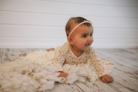 stunning baby girl in lacy romper