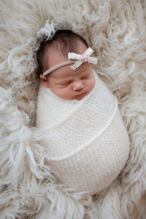 beautiful wrapped baby girl in white
