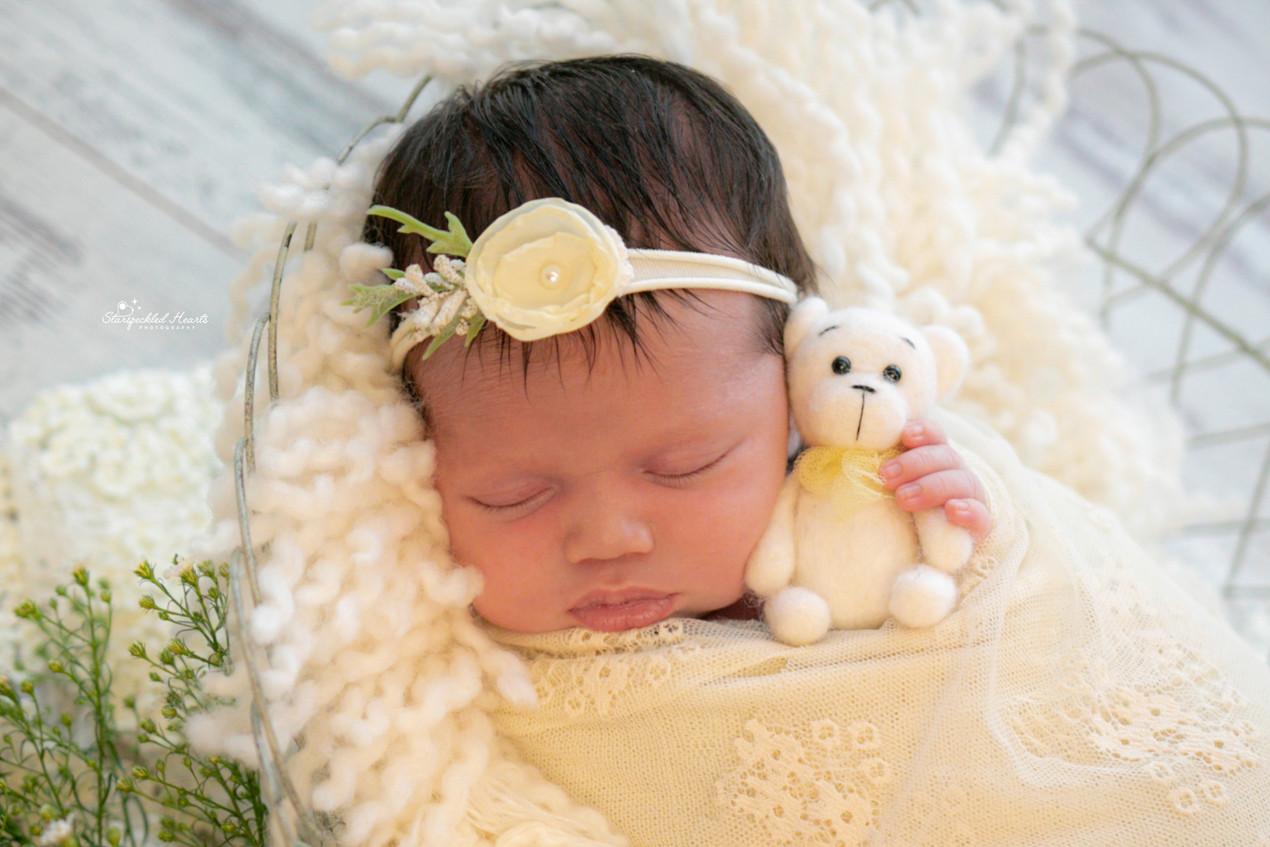 sleeping newborn baby girl photography
