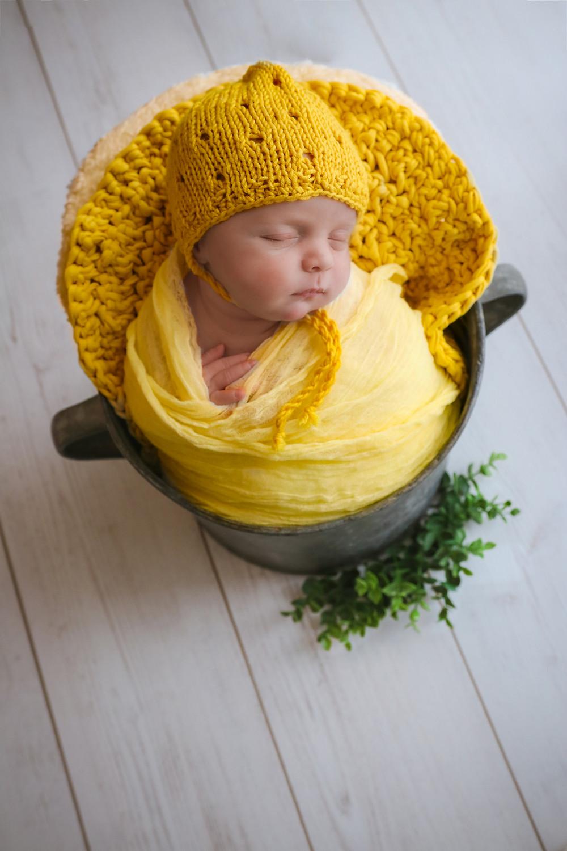 sleeping newborn in yellow