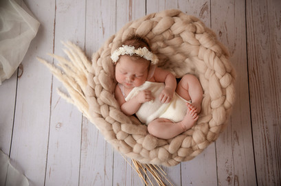 newborn photography session in surrey of baby girl lying in a woven basket