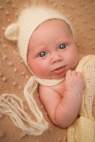newborn girl with big blue eyes looking at the camera