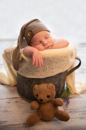 sleeping baby boy in a bucket
