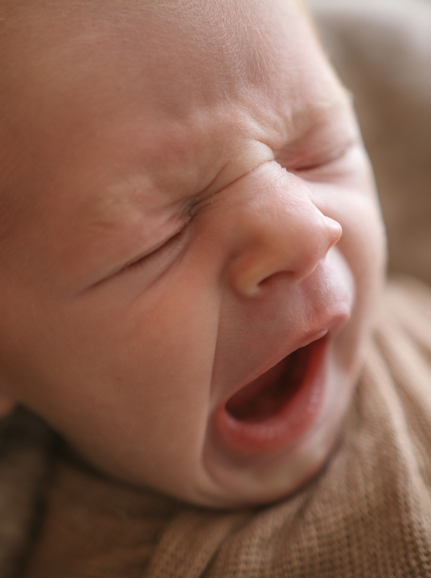 closeup of newborn yawning
