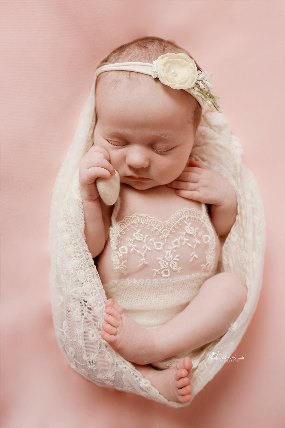 gorgeous sleeping newborn baby girl