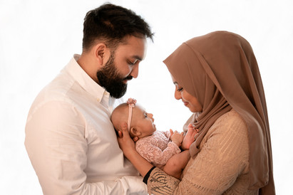 family portrait of a mum, dad and baby girl for their 2 month session with starspeckled hearts photography in aldershot hampshire