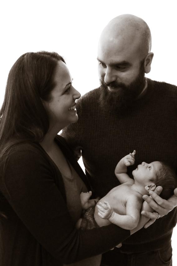 newborn boy and parents family portrait