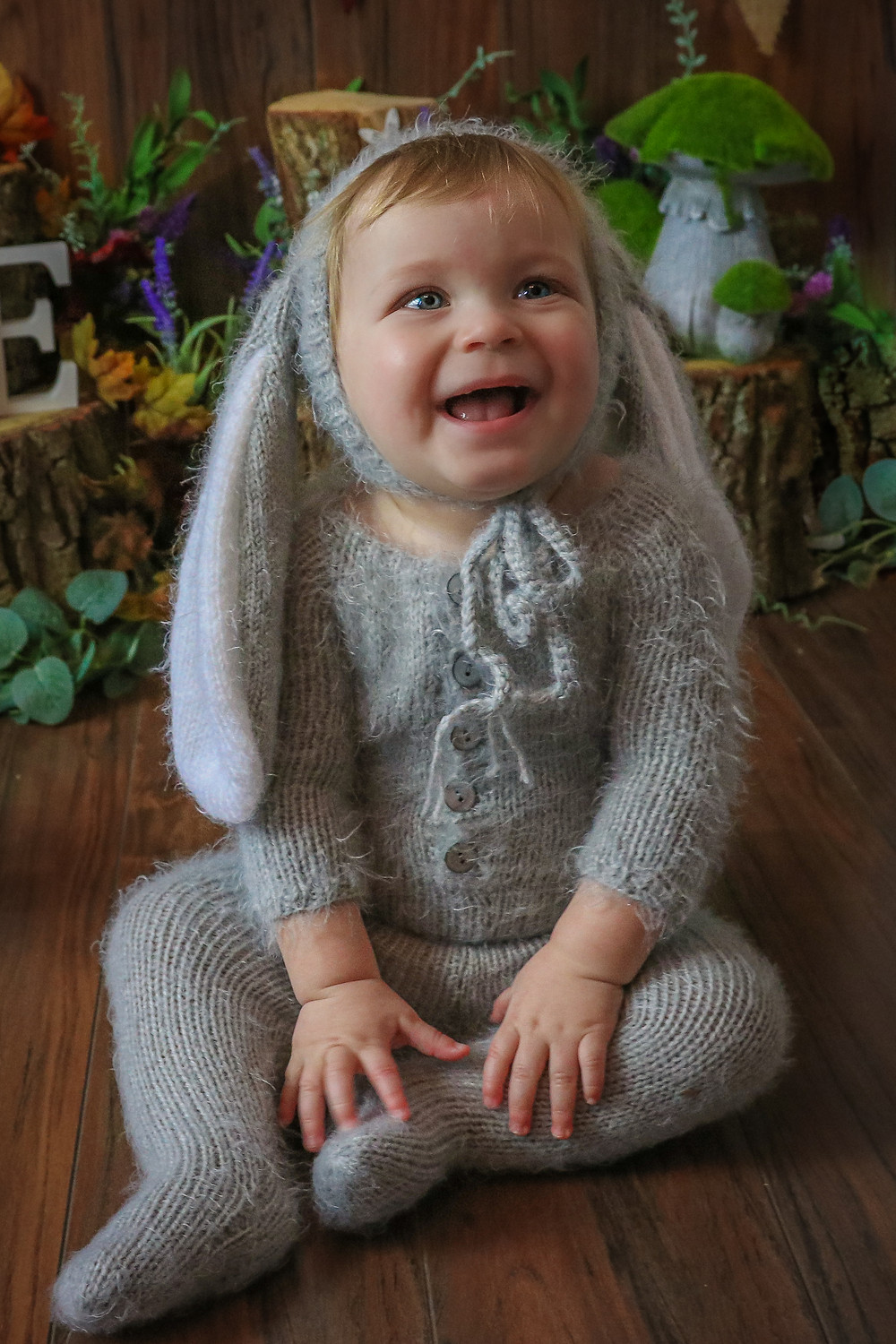little boy wearing bunny outfit smiling
