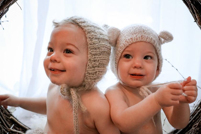 twin boys wearing matching bonnets