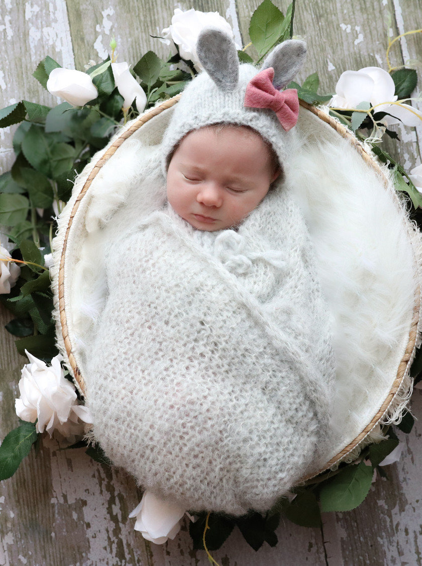 sleeping newborn wearing grey bunny bonnet