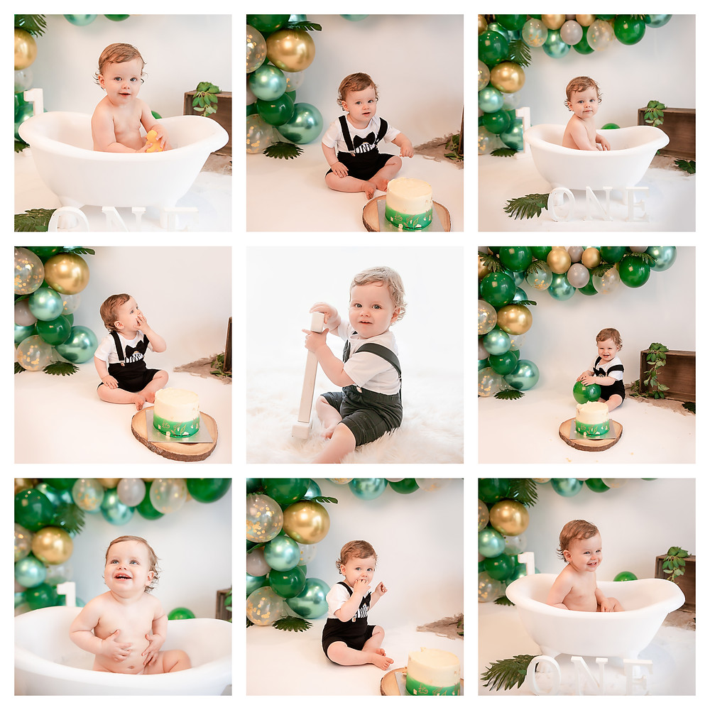 adorable baby boy in cake smash outfit clapping his hands