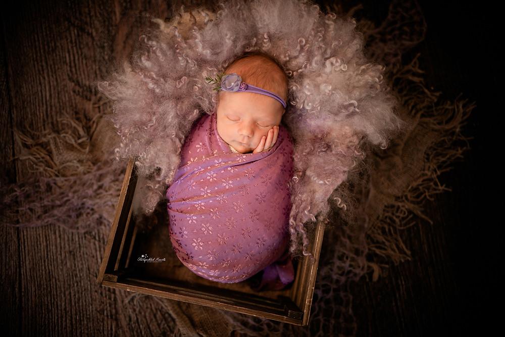 beautiful baby girl wearing purple
