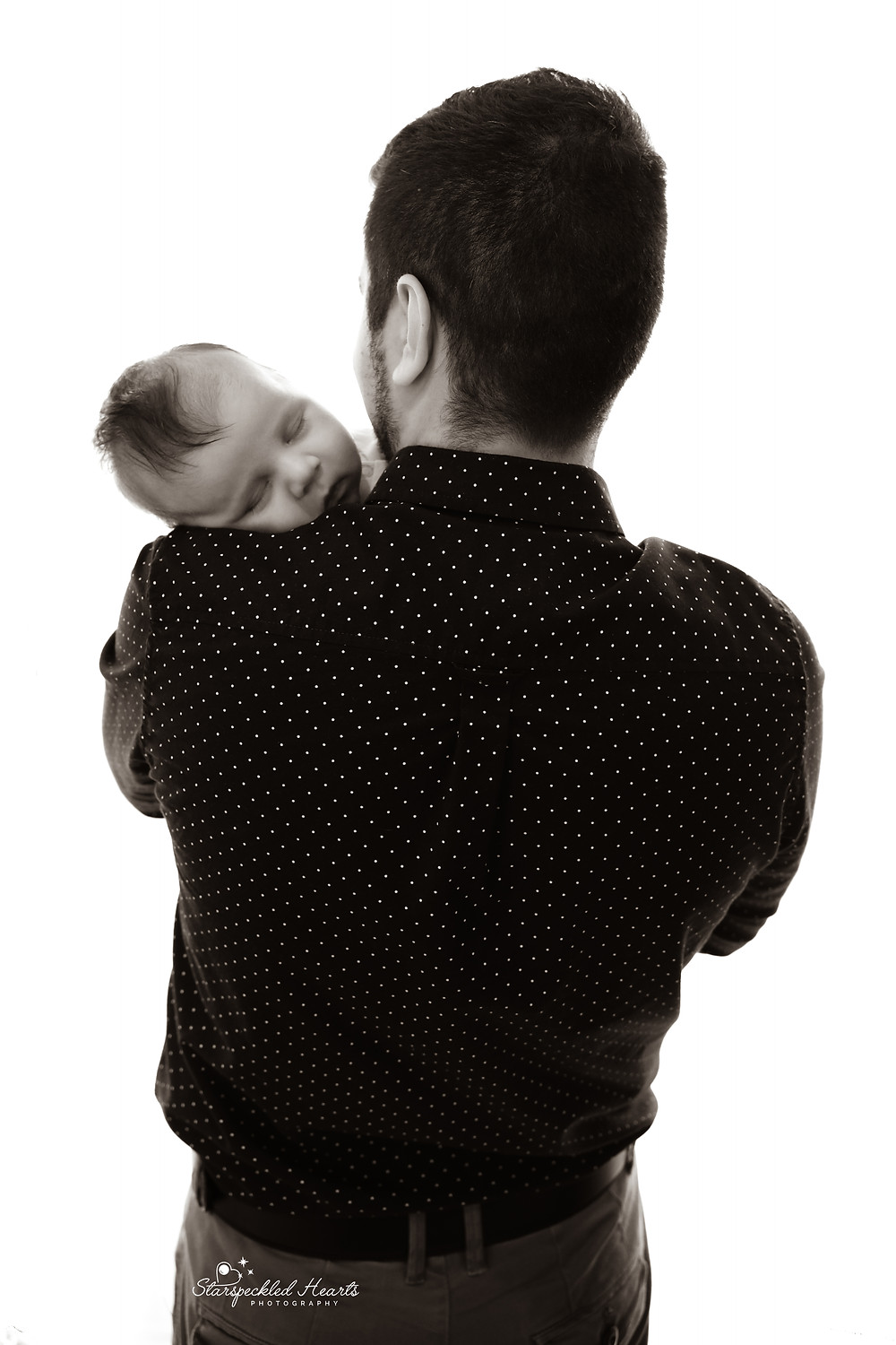baby boy fast asleep on his fathers shoulder