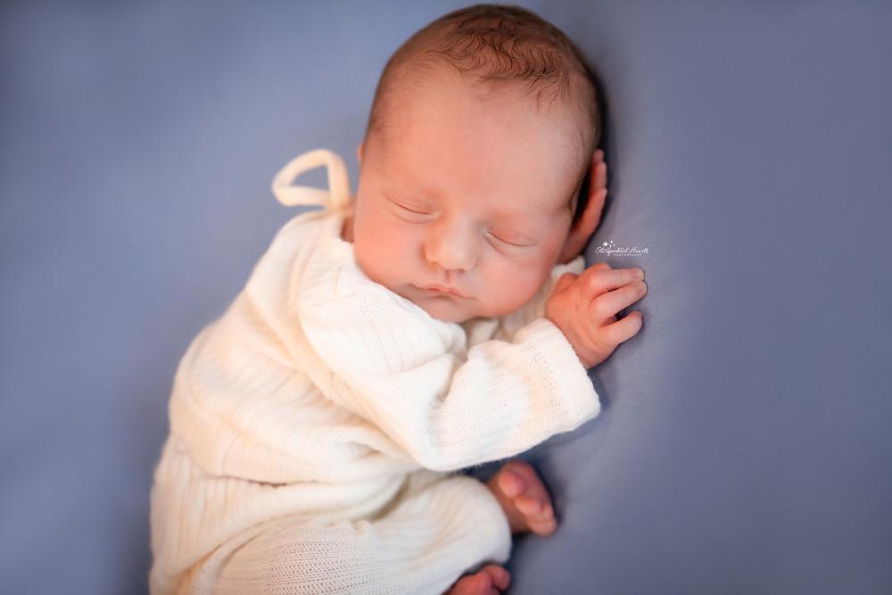 gorgeous sleeping baby boy wearing white