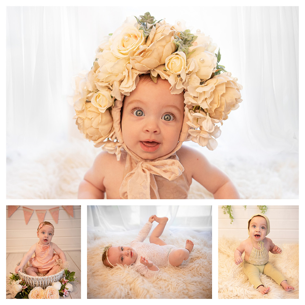 adorable baby girl wearing a flower bonnet with big blue eyes