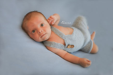 newborn baby boy in blue