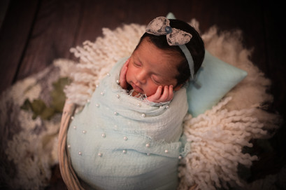 newborn baby girl in blue, best newborn photographer hampshire surrey