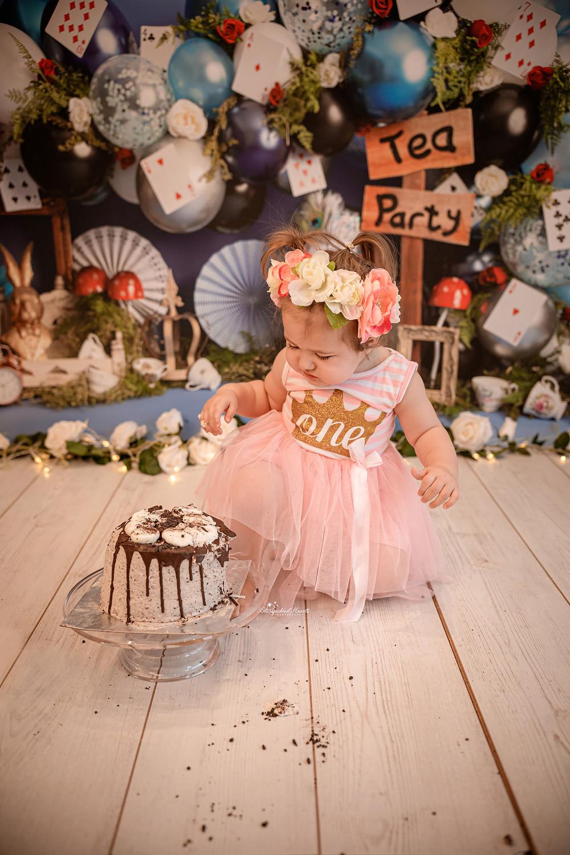 cute baby girl alice in wonderland cake smash session
