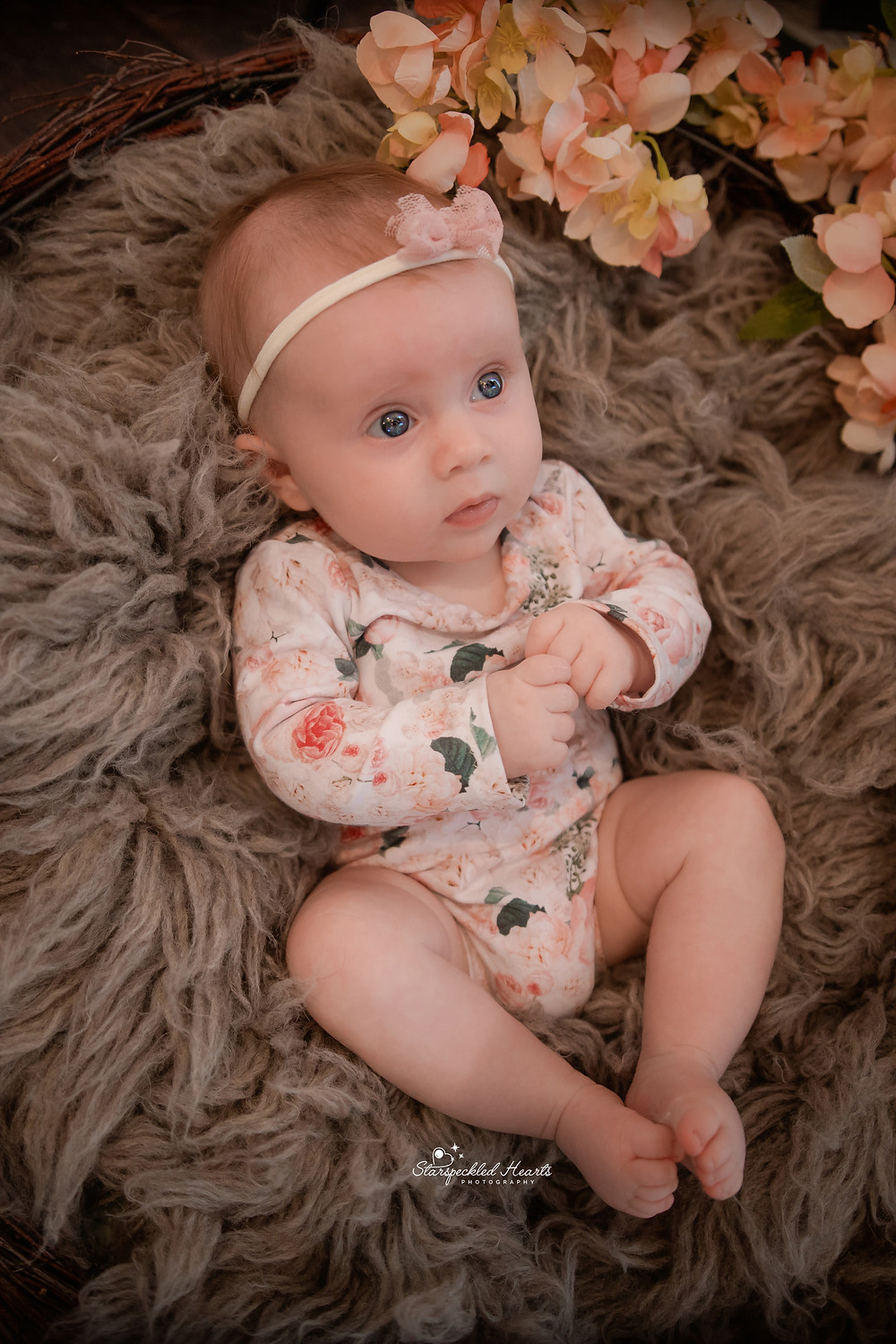 cute baby girl wearing a floral romper