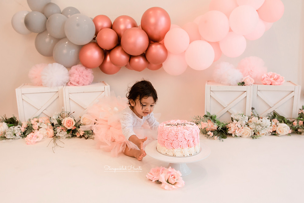 A girly first birthday cake smash and splash session in Aldershot, Hampshire