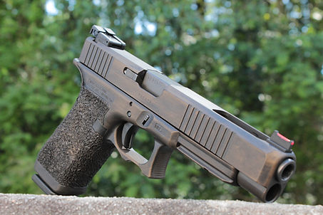 Custom Glock 35 with front cocking serrations, double undercut, and bordered stippling.