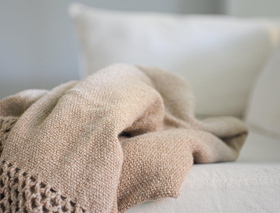 Pie de cama de lana de llama