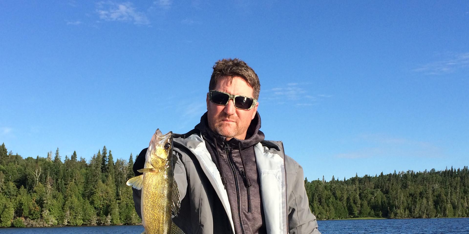 Colin with a walleye on Shekak Lake