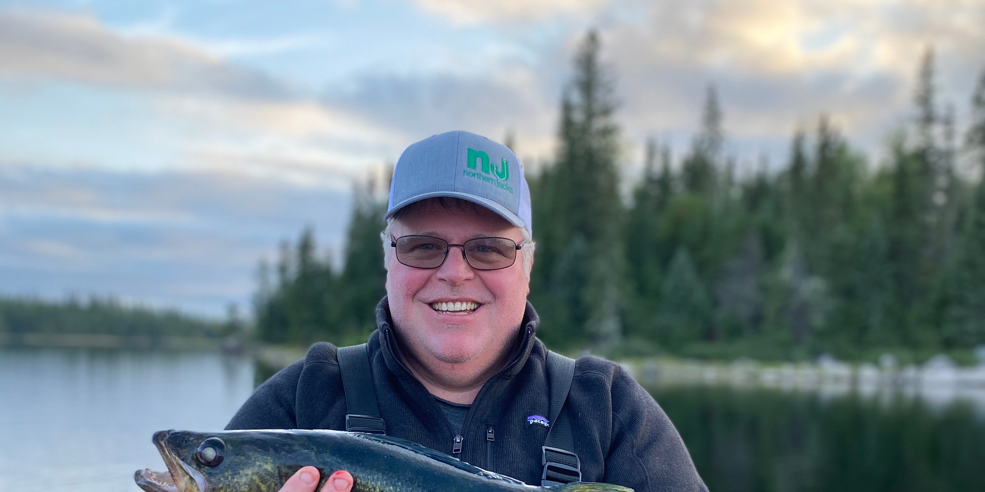 Possibly my favorite picture - Dave w a beauty on Lake St Joseph