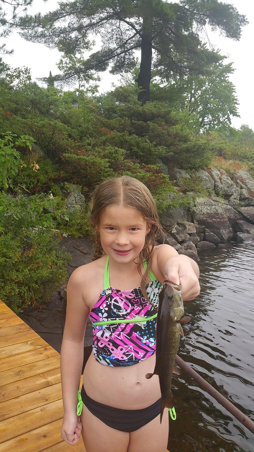 Girl qith a nice bass caught in Muskoka, Ontario