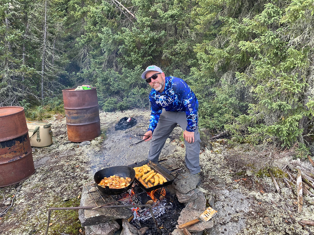 Shore lunch on a fly in fishing trip in Northern Ontario, Canada