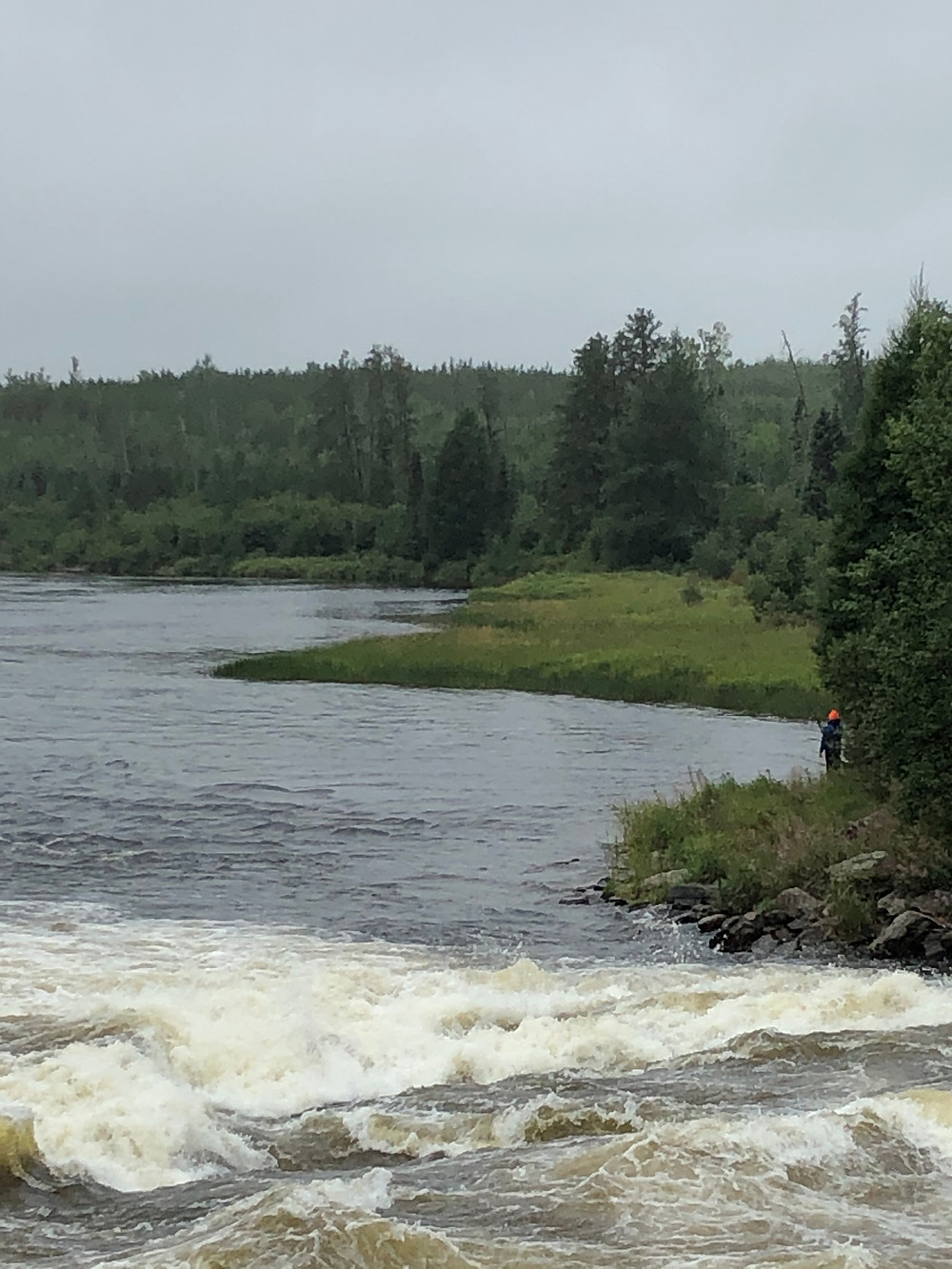 Fishing at the rapids on a fly in fishing trip in Northern Ontario, Canada