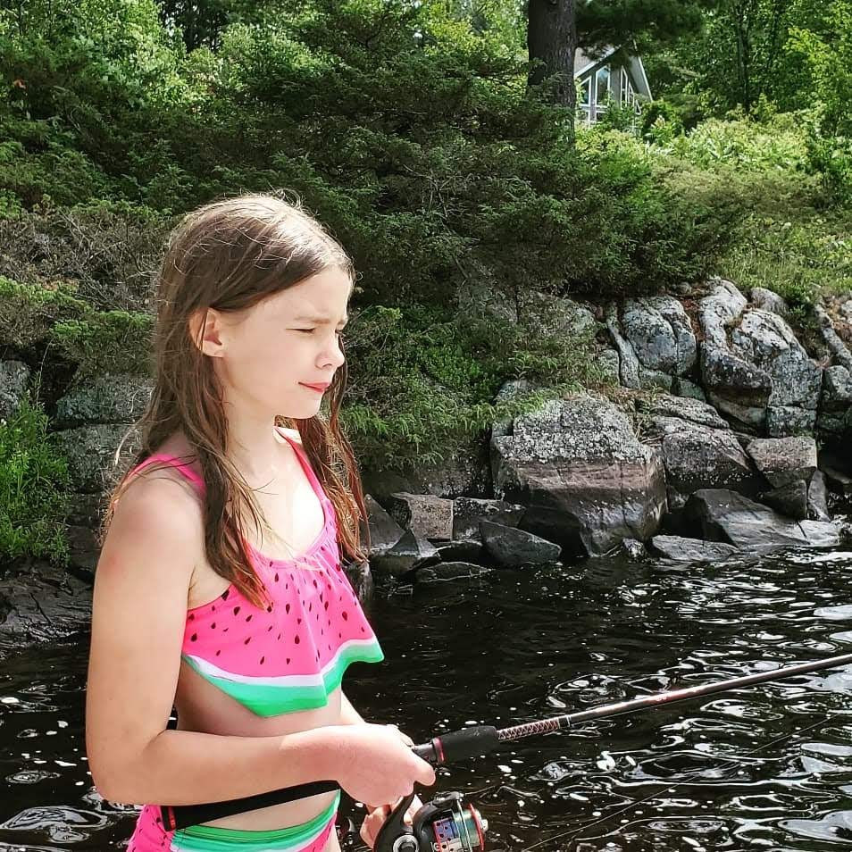 Molly looking for bass off the dock