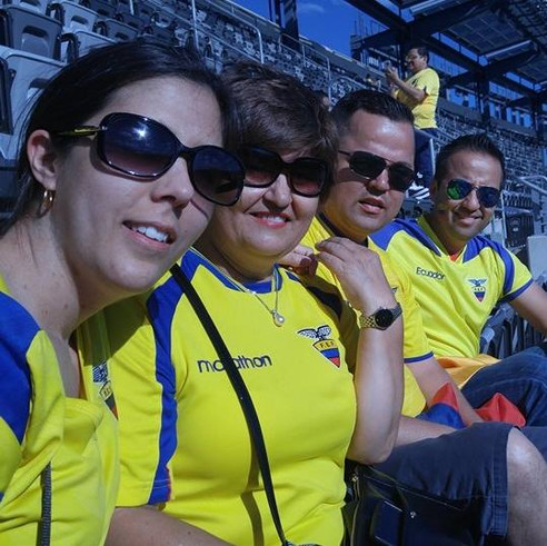 Watching the Ecuadorian soccer team with Anna's mom and brothers.