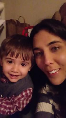 Anna celebrating Christmas with our nephew.  Anna celebrando Navidad con nuestro sobrino.