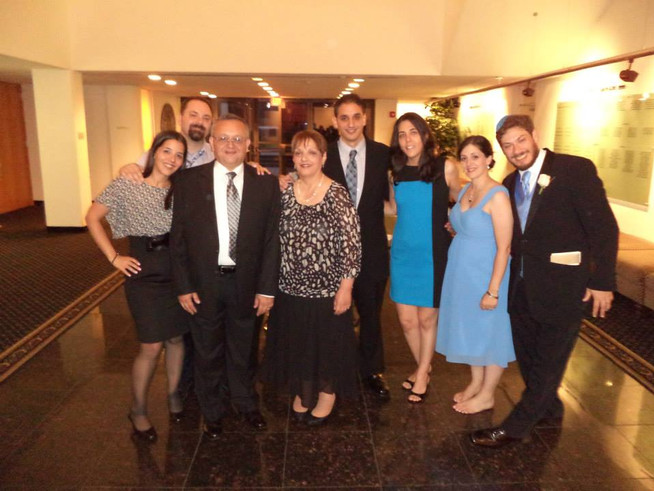 Celebrating a friend's wedding with our sisters, brother in laws and parents.