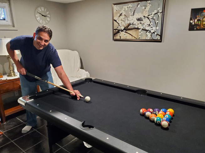 Breaking in a game of pool in our basement