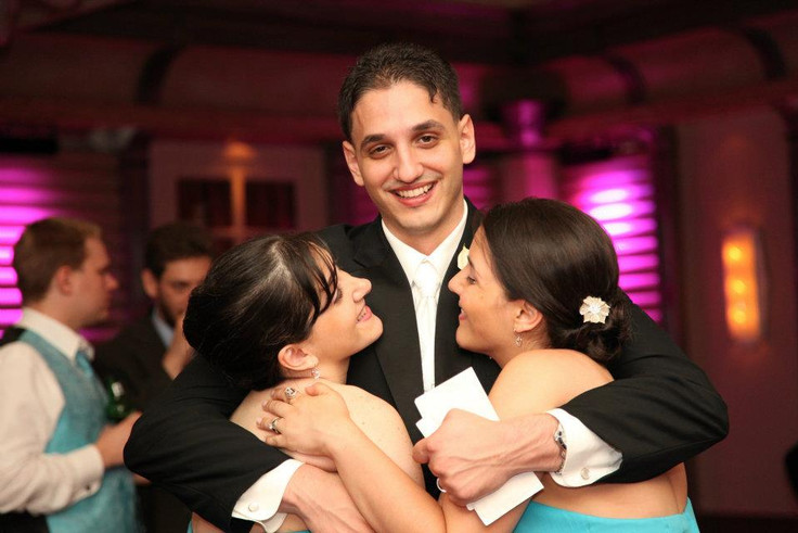 Tom with his sisters at our wedding