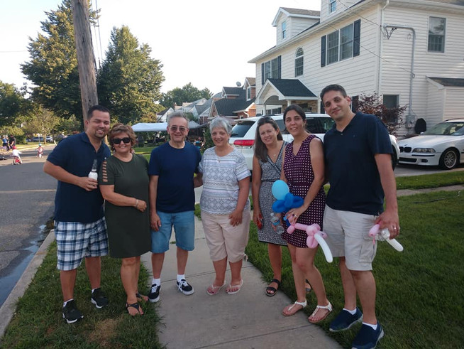 Enjoying our block party with Anna's brother, mom, Tom's parents, and Anna's cousin.